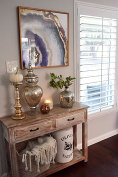 Greet your guests at the entryway with an inviting console table dressed in Fall decor.  HomeGoods Sponsored Pin.