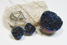 Sterling Silver Gemstone Pendant Necklace and Dangle Earrings with Titanium Blue Druzy This is incredibly gorgeous! I've seen these stones in person and they are drenched in color and depth! My friend at ETSY shop earringexchange makes this unique, hand-crafted, high quality jewelry. She is also hoping to go back to school soon and needs to finance that endeavor. Help yourself by buying incredible jewelry and help her to go back to school through your purchase!
