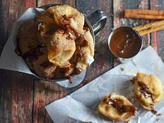 Crispy Cinnamon-Sugar-Coated Cream Cheese Wontons With Nutella-Dulce de Leche Dipping Sauce Recipe | Cinnamon sugar cream cheese wontons are the dessert dumplings of your dreams.