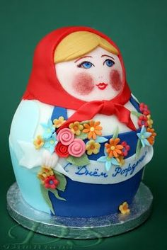 The Polish heritage in me just LOVES this little lady in a babushka! (I wonder if you cut inside...there is another and another and another!) lol