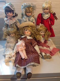 "I'm not familiar with these dolls. I was given them from my mom. All appear to be the The Heritage Mint Ltd. Collection Porcelain Dolls. Five of the dolls are approximately 16"" long, the one with the hat is approximately 19"" long and then the tiny one. Price is for all seven dolls. Also includes 3 stands. 