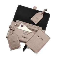 Classic Plain Travel Collection in Pewter Lizard from Aspinal of London - love this! Travel wallet with matching passport holder & luggage tags. Free personalization too!