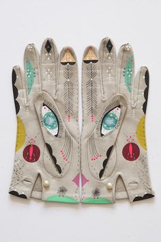 kitten3.jpgMy Cosmic Animal Gloves are one of my favorite on-going projects where I get to play with the idea of old and new, symmetry and our strange connection to the cosmic world of spirit animals. These darlings are hand-painted, museum-quality framed and unique in every possible way. I often have a set for sale in my studio, so please contact me for more details: bunniereiss@gmail.com