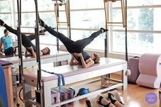 Hong Chin corrects her own form in the The Scissors #Pilates movement.