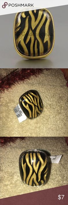 Chic tiger print ring Chic tiger print ring.  Gold undertones in a gold setting.  One size fits all. NWT.  Reasonable offers considered. Jewelry Rings