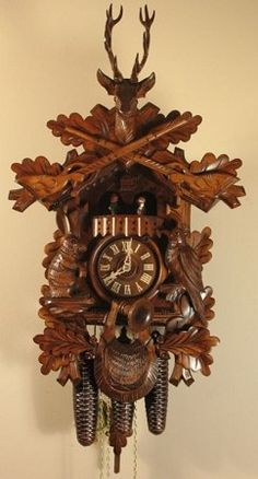 Model 8330 Hunter S Cuckoo Clock With Live Animal Theme This Large And Beautifully Carved