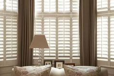 A smart and streamlined look with these shutters for a bay window in Berkhamsted