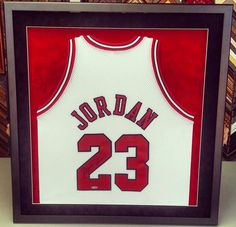 Custom framed Michael Jordan jersey using acid-free suede matting and conservation glass. Our stitching methods are also reversible so your memorabilia will not be harmed. Let us help make your favorite jersey look great! Custom framed by FastFrame of LoDo! #art #framing #denver #jersey #shadowbox #chicago #bulls #michaeljordan