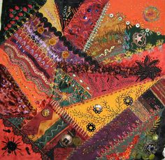 I ❤ crazy quilting . . . La Vida Laredo  I just completed work on a block I started several years ago.  I was about a third of the way through when I had to put it aside. I left everything I'd done before as it was and added more embellishment.