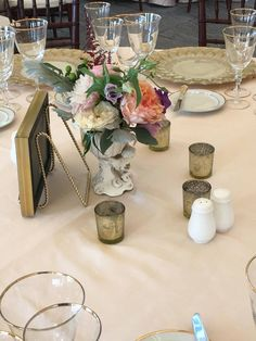 Vintage vase holds Victorian Era inspired flowers at a reception at Castle Hill Inn.