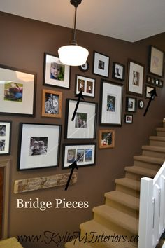 ideas for how to make a photo gallery or artwork display going up a stairway or stairs