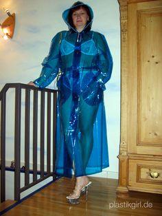 Gaby from Duesseldorf wearing a clear blue PVC Raincoat from kemo-cyberfashion.de