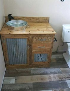 Free Shipping. Rustic wood vanity built to your specs, with stain or paint finish of your choice. Vanity comes with galvanized sink tub installed with drain hole. Vanity as shown measures 31 x 22 x 31 (excludes faucet). **Upgrades - Faucet added for $75, two choices available. Sink #RusticBathrooms