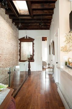 A brownstone in Harlem, renovated and decorated in French Colonial style, with white as the dominant color, whitewash. Brownstone Interiors, New York Brownstone, Interior Architecture, Interior And Exterior, Build A Closet, Exposed Brick, Home Fashion, Interior Design Inspiration, Home Renovation