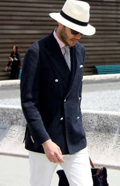 The panama hat and double breasted coat.