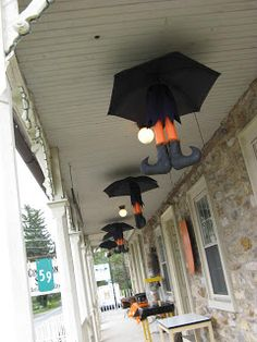 Umbrella hanging Halloween witch legs. Cute on a front porch