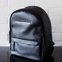 Danielle Nicole Black Vegan Leather Backpack {Please contact for purchase and separate listing will be created for you}.                                                         A classic black vegan leather backpack. Bag is made with quality faux leather materials. Front exterior zip pocket. Bag feature large inside pocket for laptop or tablet. Interior zip pocket and 2 interior loose pockets. Great clean lines. Adjustable back straps. 11W x 12L x 5D. Danielle Nicole Bags Backpacks