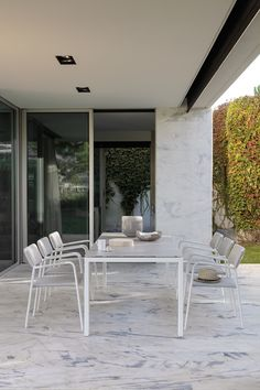 Outdoor dining chair ECHO by Manutti. Stackable, light, soft, rope, powdercoated aluminium. Terrace, garden furniture. Marble floor.