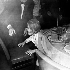 Marlene Dietrich, opening night party, hiding from photographers, NYC, 1968 by Elliott Landy