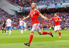 Aaron Ramsey of Wales celebrates scoring his team's first... - http://euro2016.abafu.net/football/aaron-ramsey-of-wales-celebrates-scoring-his-teams-first