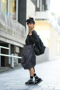Id do this with heels & kill the back pack and add a hand bag. Add a crisp white V neck tucked in and bingo!  comme des garcons