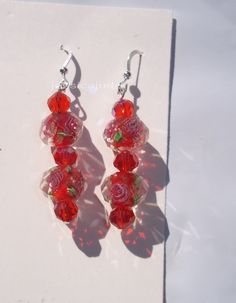 FLORAL GLASS AND SWAROVSKI EARRINGS- RED http://www.listia.com/auction/13227781-floral-glass-and-swarovski-earrings-red
