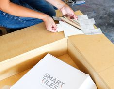 No fireplace? Check out how you can make your own renter-friendly DIY faux fireplace with peel and stick tiles available at The Home Depot! Faux Fireplace Mantels, Candles In Fireplace, Christmas Fireplace, Fireplace Inserts, Fireplace Design, Rental Home Decor, Home Wall Decor, Diy Home Decor, Peel And Stick Tile