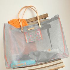 Repurpose your old window screen into a handy mesh tote with Between the Lines, featured at www.totallygreencrafts.com