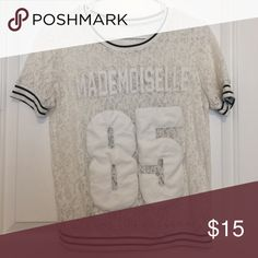 """white lace """"jersey"""" style top slightly baggy jersey style top with lace detailing and black and white stripes. I don't remember what brand it's from because it was purchased in Hong Kong! WILL FIT S-M Tops Tees - Short Sleeve"""