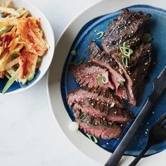 Grilled hanger steaks with kimshi apple slaw, F&W A simple soy-sauce marinade gives great flavor to tasty grilled hanger steak, served here with a creamy, tangy apple-and-kimchi slaw. Good Steak Recipes, Slaw Recipes, Grilling Recipes, Wine Recipes, Beef Recipes, Cooking Recipes, Grilling Tips, Korean Recipes, Korean Food