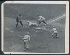 Check out this fantastic vintage 1920 International press photo from game 2 of the World Series.  Hall of Fame pitcher Burleigh Grimes is shown scoring the second run in the game on a double by Tommy Griffith.  As you can see, Cleveland Indians catcher Steve O'Neil is unable to make the tag on a sliding Grimes.  Although the Dodgers didn't win the crown this season there were plenty of highlights.  For instance, Burleigh Grimes would go on to pitch a seven hit shutout to bring the Robins…