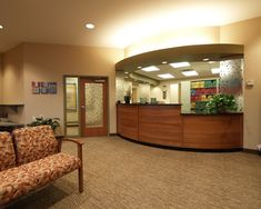 Dental Care Associates of Buffalo.  This reception area uses warm colors, decorative panels and horizontal cherry panels to comfort the visitor.