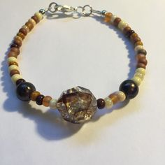 Brown amber sand natural neutral beach mermaid beaded clasped bracelet by GSellsSeashells on Etsy https://www.etsy.com/listing/275752054/brown-amber-sand-natural-neutral-beach