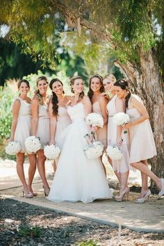 Love the mix and match of the bridesmaid dresses