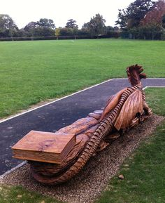 DRAGON BENCH by TOMMY CRAGGS http://www.treesculpting.co.uk/