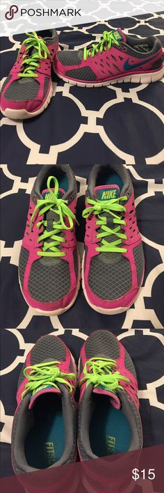 Nike Fitsole size 9 Pink, Grey, with green laces Nike Fitsole size 9 ladies shoes. Magenta pink with grey mesh. The shoe laces are neon green and the swoosh on the side is teal. Fun shoes to work out in. Wear at the bottom, other than that, they look sharp. Nike Shoes Athletic Shoes