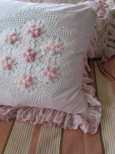 Crochet Lace with raised pink flowers - If you like frilly, lace and thread crochet, you'll like this site.