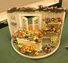 Flower shop exterior and interior displayed on a turntable, with only a structural front wall.