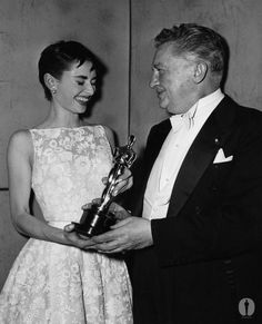 Best Actress Audrey Hepburn (Roman Holiday) with Jean Hersholt at the 26th Academy Awards.