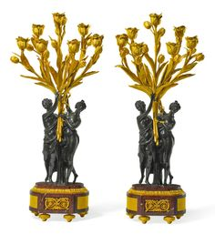 A pair of Louis XVI style gilt and patinated bronze seven-light figural candelabra late 19th century, after the model by Etienne-Maurice Falconet (1716 - 1791).