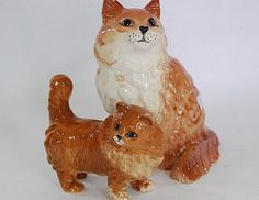 A pair of Beswick porcelain cats various