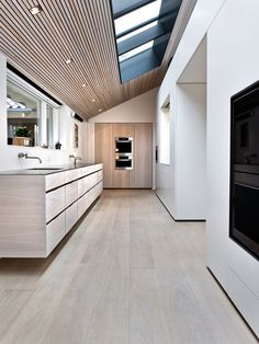 love the slatted wood on the skylight extension...