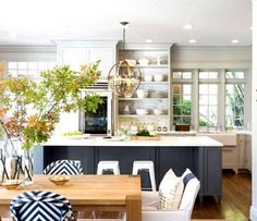 Crisp, airy and light-filled happy kitchen.