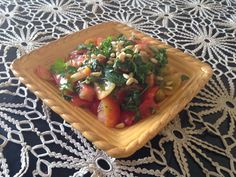 Garden tomatoes and pesto (variety of garden herbs...parsley, basil, cilantro, garlic, real salt, pinenuts, chives).  Make extra of it all and keep it in the fridge for next meal...add soba noodles and you've got dinner!!! We could eat garden tomatoes for breakfast in this house!  They go like hot cakes!!!