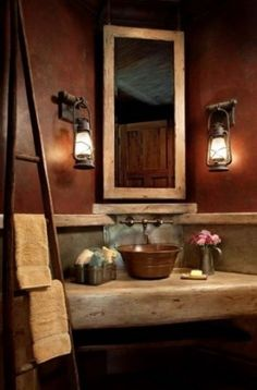 rustic bath with faux leather walls, copper sink, & antique oil lamp light fixtures
