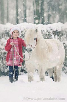 Nice winter day for a walk with her miniature horse.