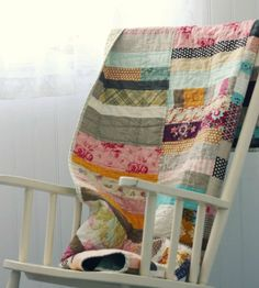 Love this strip quilt.  What a great way to use small pieces of leftover fabric that might otherwise go to waste.