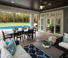 Shingle Style Home with Casual Coastal Interiors The backyard has a pool and a screened in porch wit Screened Porch Designs, Screened Porches, Covered Porches, Enclosed Porches, Outdoor Covered Patios, Back Porch Designs, Screened Pool, Outdoor Patios, Indoor Outdoor