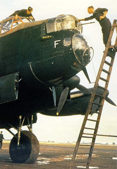 A Lancaster getting 'the once over' before embarking on another raid on Germany - RAF - World War 2