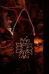 This is a guide about making a tin punch lantern. You can easily turn an empty tin can into a beautiful lantern. Simply punch a pattern into its surface and place a candle inside to illuminate it.